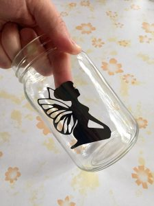 Position fairy inside jar