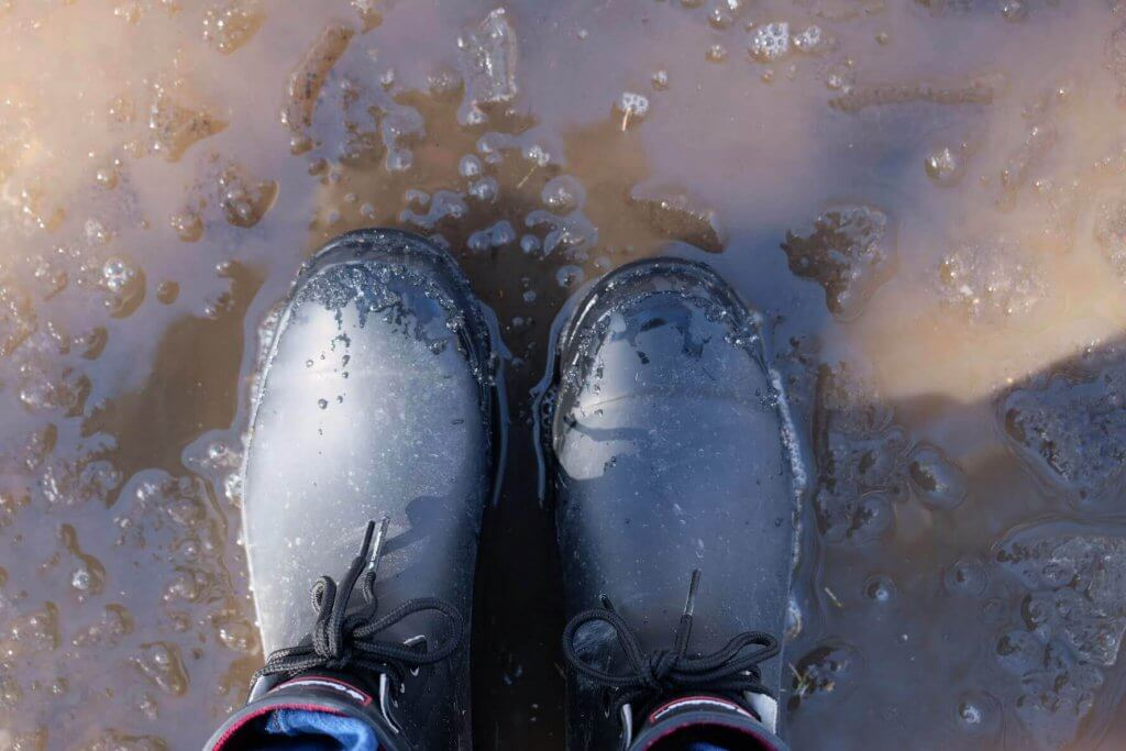 rubber boots in a puddle